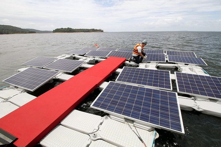 Floating solar panels atop the artificial lake at Balbina dam, whose power station now produces only a fraction of the output originally planned. Engineers aim to eventually crank out 300MW with the new panels.