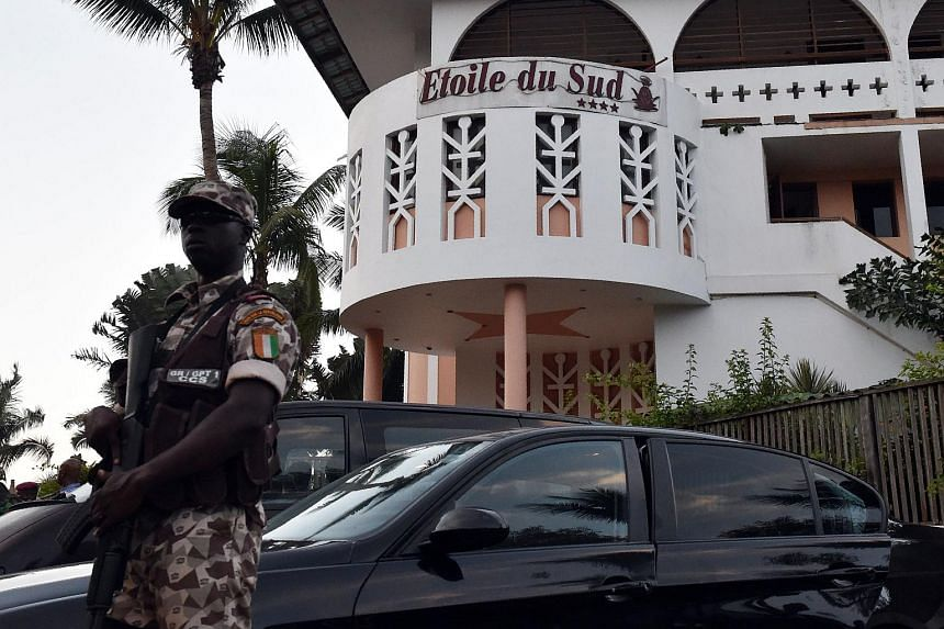 An Ivorian soldier standing guard in front of the Etoile du Sud, one of the hotels attacked by heavily armed men on March 13, 2016, in the Ivory Coast beach resort of Grand-Bassam.