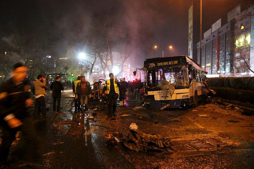 Emergency workers work at the explosion site in Ankara, Turkey on March 13, 2016.
