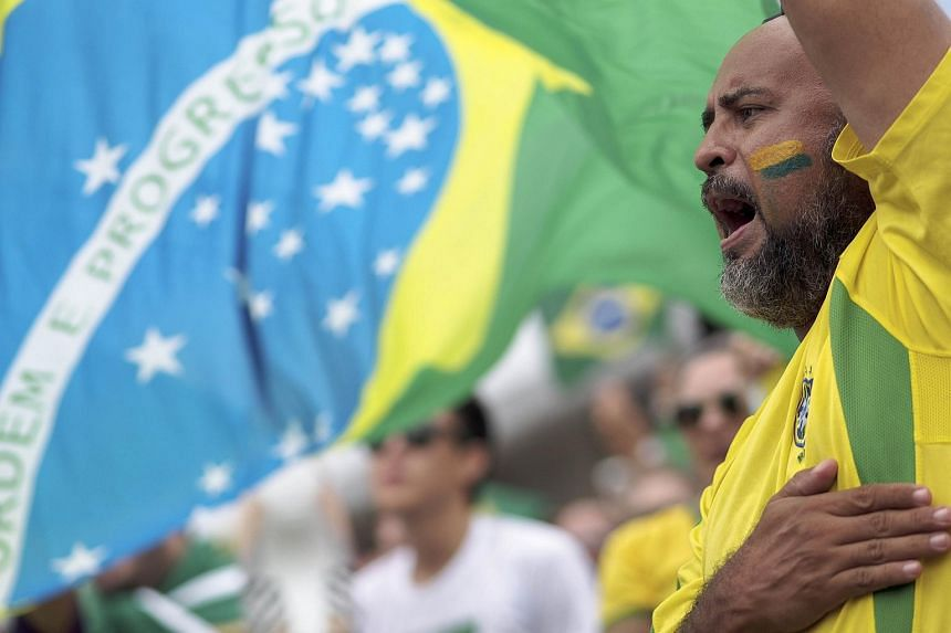 A man joins thousands in protests against Brazilian President Dilma Rousseff and the corruption cases being investigated on March 13, 2016.
