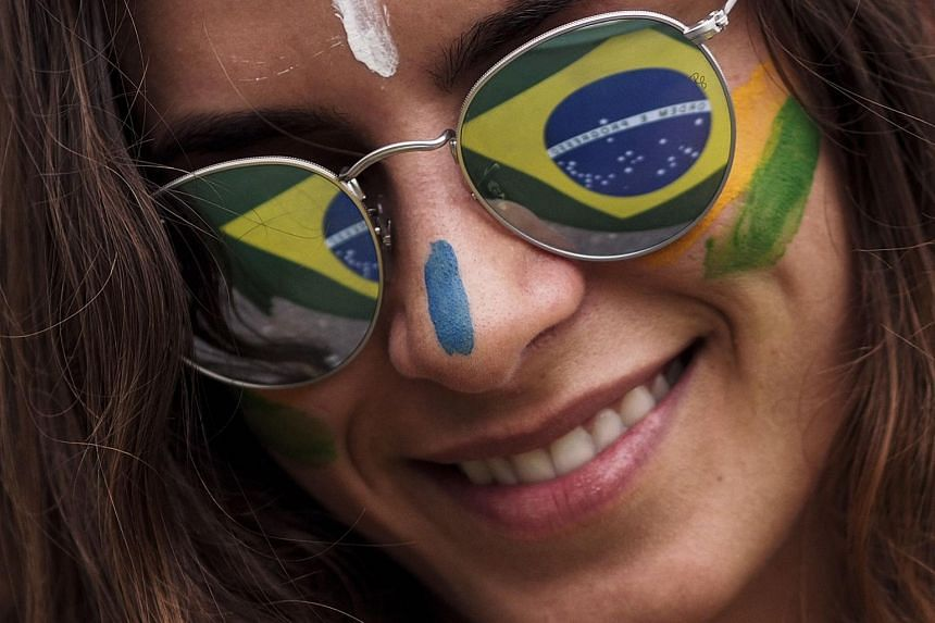 A woman with a painted face joins protests against Brazilian President Dilma Rousseff and the corruption cases being investigated on March 13, 2016.
