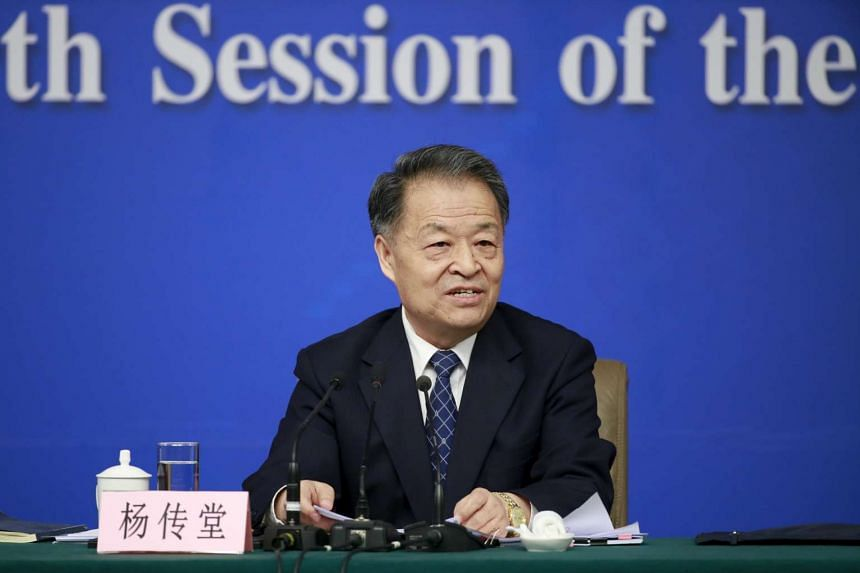 China's Minister of Transport Yang Chuantang speaks at a news conference on March 14, 2016.