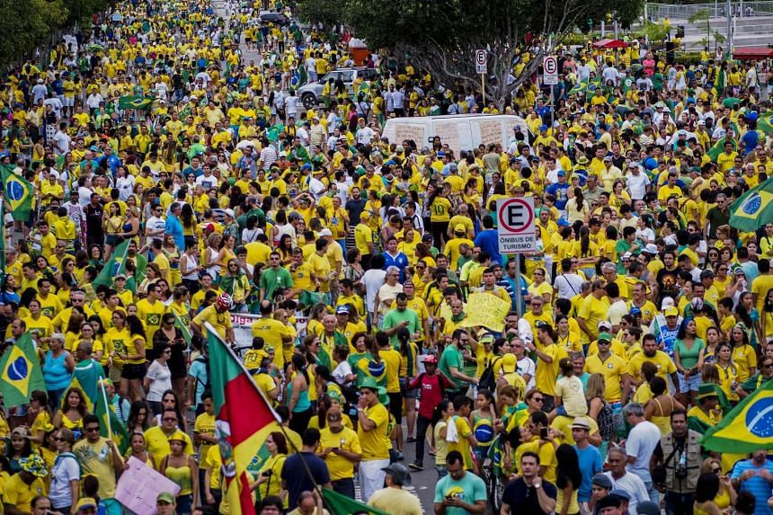 Thousands of demonstrators protest against Brazilian President Dilma Rousseff and the corruption cases being investigated in Brazil, on March 13, 2016.