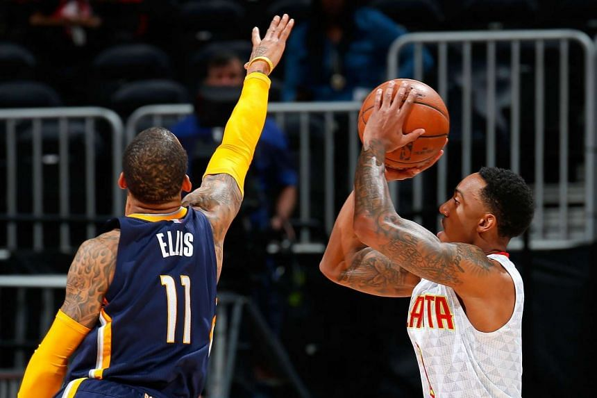 Jeff Teague (right) of the Atlanta Hawks shoots against Monta Ellis of the Indiana Pacers.
