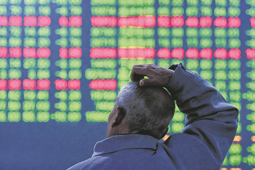 An investor sits in front of a screen showing stock market movements at a securities firm in Hangzhou, on Jan 11, 2016.