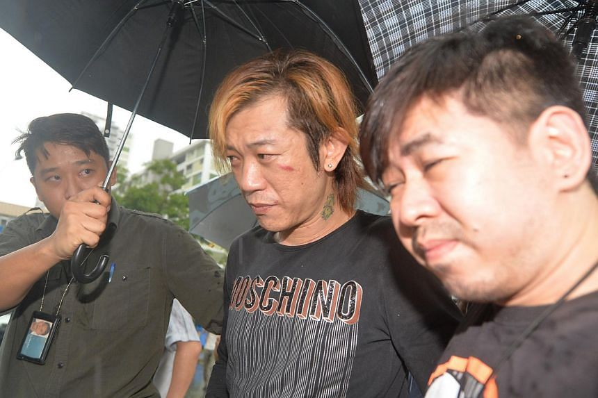 Jackson Lim Hou Peng (centre), flanked by police officers. He was arrested for the murder of a Vietnamese woman, Tran Cam Ny on Nov 20, 2014.