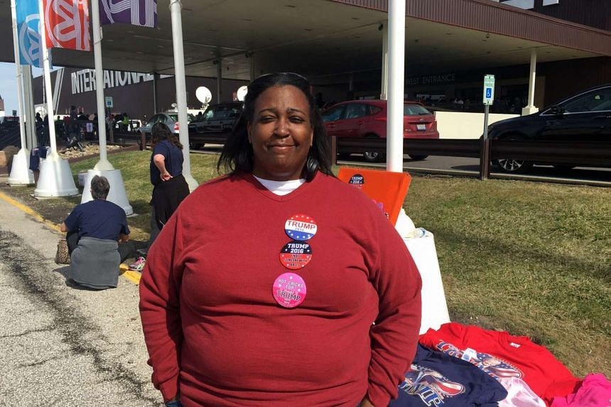 Bridget Jackson, 46, sold campaign paraphernalia for Donald Trump at his rally in Cleveland, Ohio on Saturday and said she will vote for him in Tuesday's Ohio primary election.
