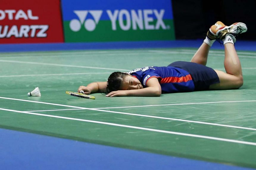 Japan's Nozomi Okuhara celebrates her victory in the women's singles final at the All England Open Badminton Championships on Sunday.