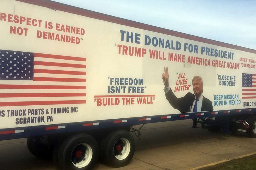 Donald Trump supporters parked a trailer truck painted with his  campaign messages at Cleveland's  I-X Centre where the Republican candidate spoke on Saturday.
