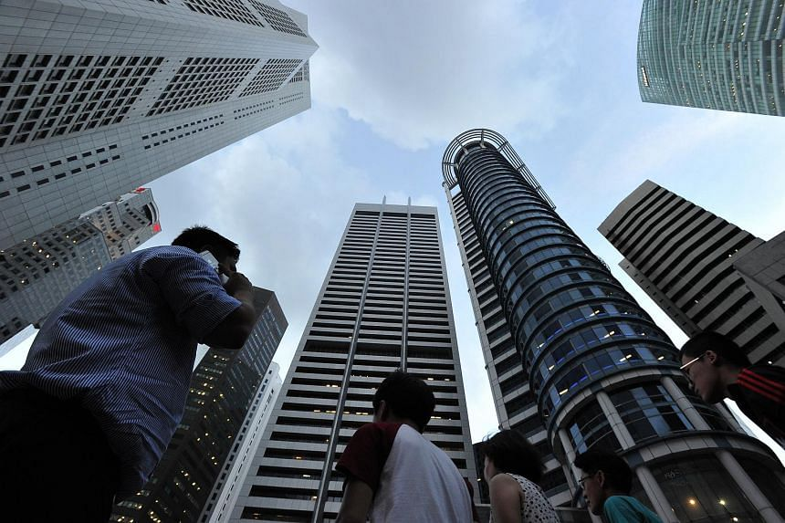 Singapore office rents may decline as much as 25 per cent in a prolonged slump that may last until the end of 2018.