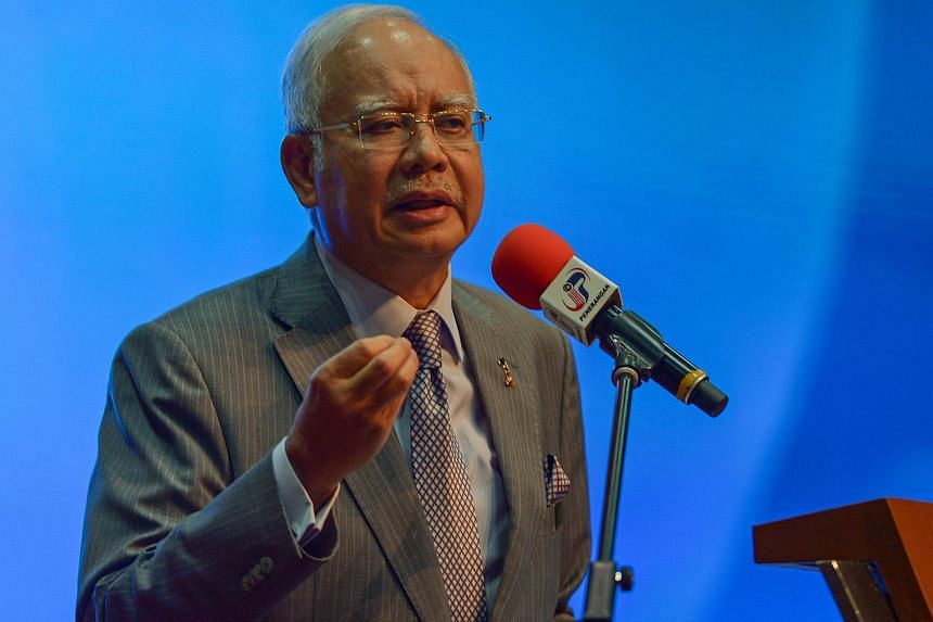 Malaysian Prime Minister Najib Razak addresses journalists during a budget review session in Putrajaya on Jan 28, 2016.