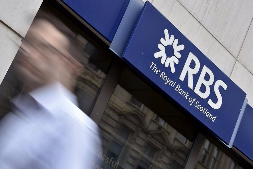 A man walking past a branch of The Royal Bank of Scotland (RBS) in central London on Aug 27, 2014.