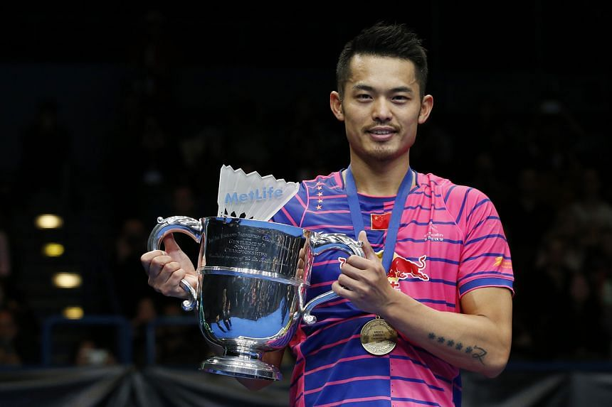 China's Lin Dan poses with the All England trophy after beating Tian Houwei 21-9, 21-10 in the singles final.