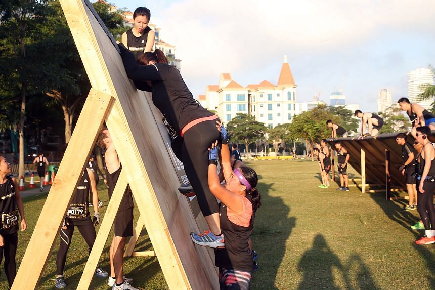 Participants had to climb over barriers and show nifty ropework at the Men's Health Urbanathlon yesterday. There were nine obstacles in all.
