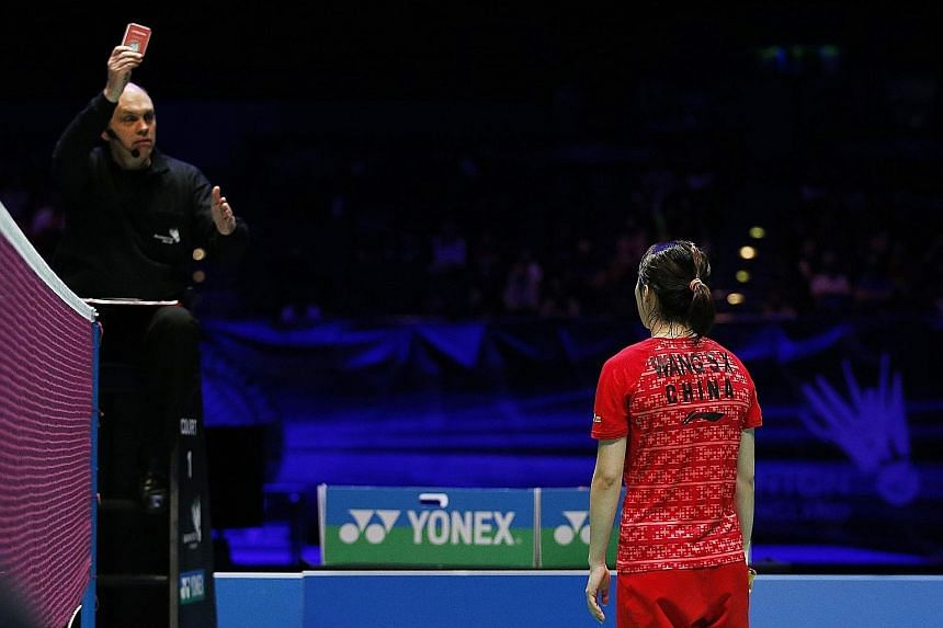 China's Wang Shixian receives a red card during the women's singles final, which she lost to Japan's Nozomi Okuhara 11-21, 21-16, 19-21.