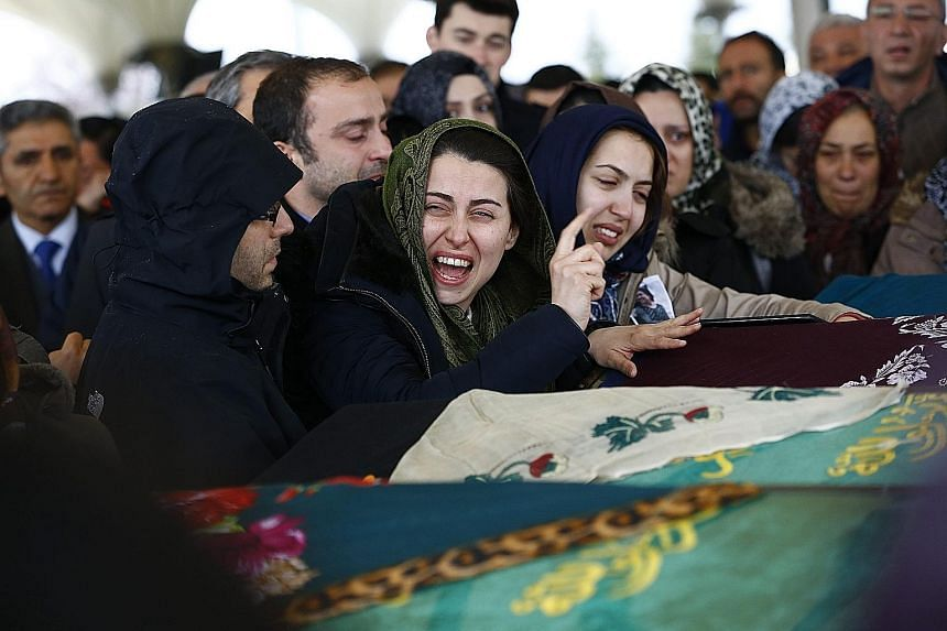 Relatives of a blast victim at his funeral in Ankara yesterday. A car bomb tore through a crowded transport hub in the Turkish capital on Sunday, killing at least 37 people. There was no immediate claim of responsibility, but evidence has been obtain