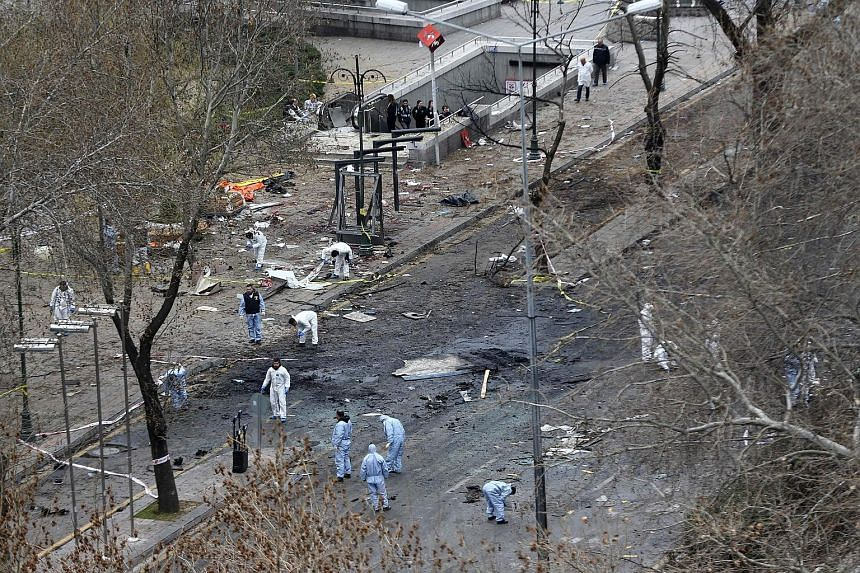 Forensic experts at the scene of the explosion yesterday. On Sunday, a car filled with explosives blew up near the busy Kizilay Square in central Ankara, killing at least 37 people. It is the third such attack to hit the Turkish capital in five month