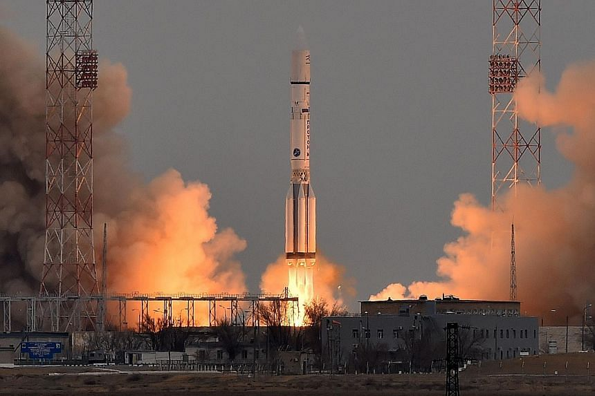 """A Russian Proton-M rocket carrying the ExoMars spacecraft blasting off from the Baikonur cosmodrome in Kazakhstanyesterday. ExoMars project scientist Jorge Vago called the Trace Gas Orbiter a """"big nose in space""""."""