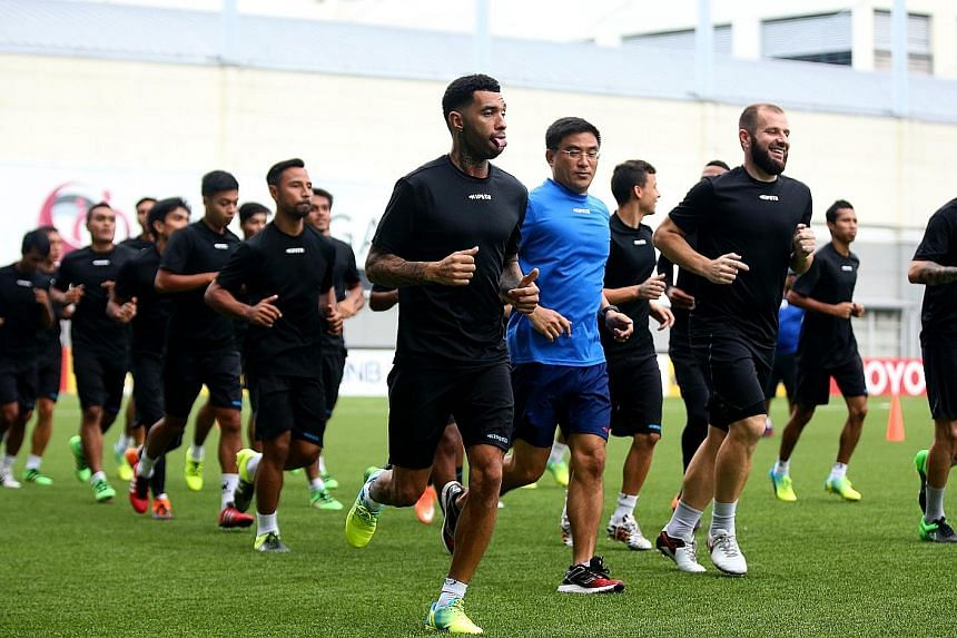 Jermaine Pennant (centre) and the Tampines Rovers squad in a training session ahead of the AFC Cup clash with Ceres La Salle today.