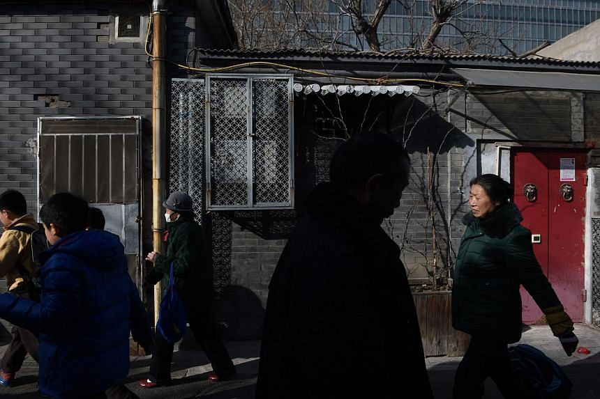 An alley in Beijing where parents are spending huge sums on tiny rooms to secure their child's spot at an elite primary school nearby, pictured on March 10.