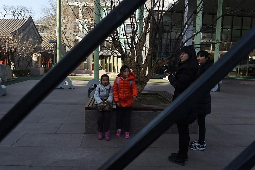 Children waiting in the Beijing No.2 Experimental Primary School on March 10.