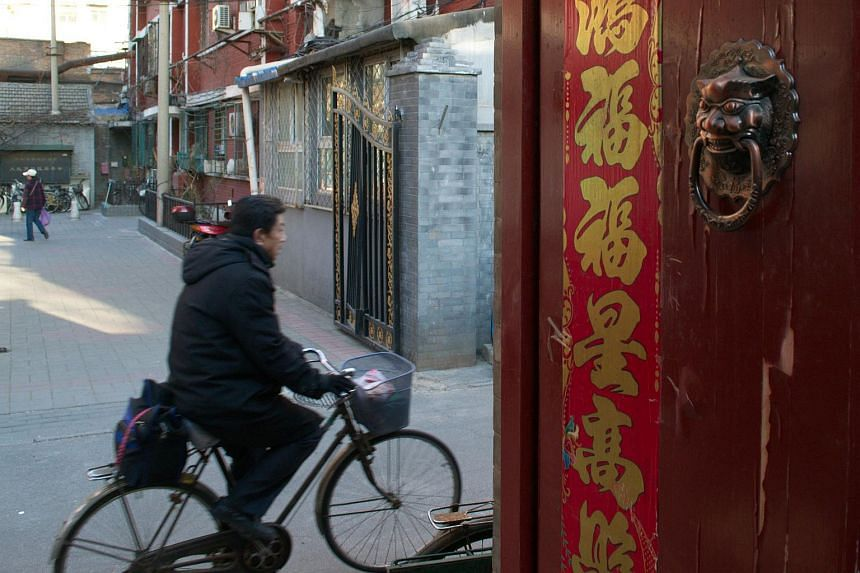 The entrance to a hallway leading to four tiny rooms in an alley near a coveted elementary school in Beijing on March 11.