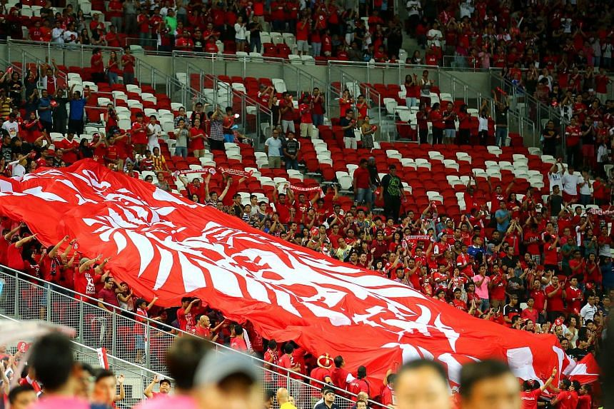 Singapore football fans moving a banner around the stadium stand during the  AFF Suzuki Cup 2014 match between Singapore and Thailand.