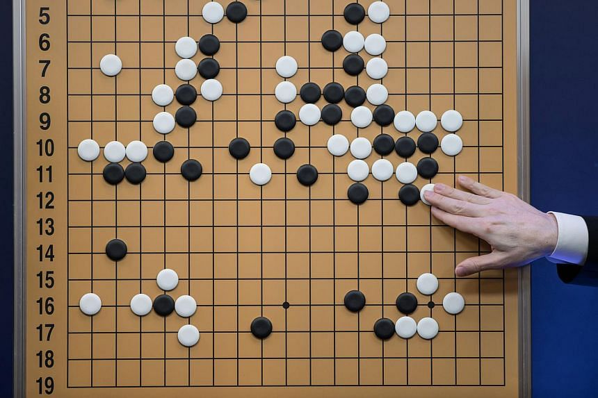 """Google's AlphaGo has been awarded the highest Go grandmaster rank, reserved for those whose ability at the ancient board game borders on """"divinity""""."""