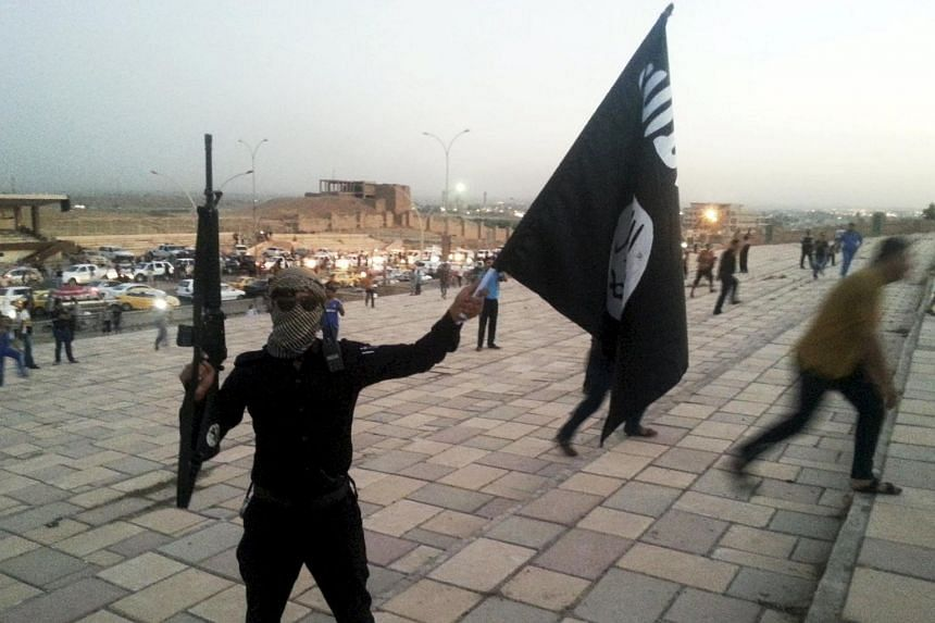 An ISIS fighter in Mosul, Iraq, on June 23, 2014.
