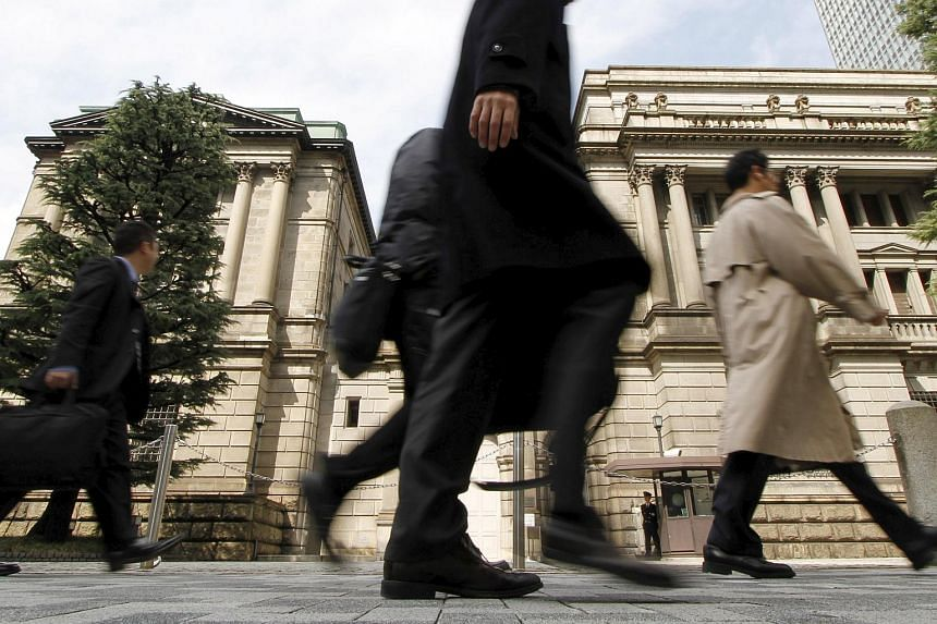 People walk past the Bank of Japan in Tokyo in this March 10, 2010 file photo.