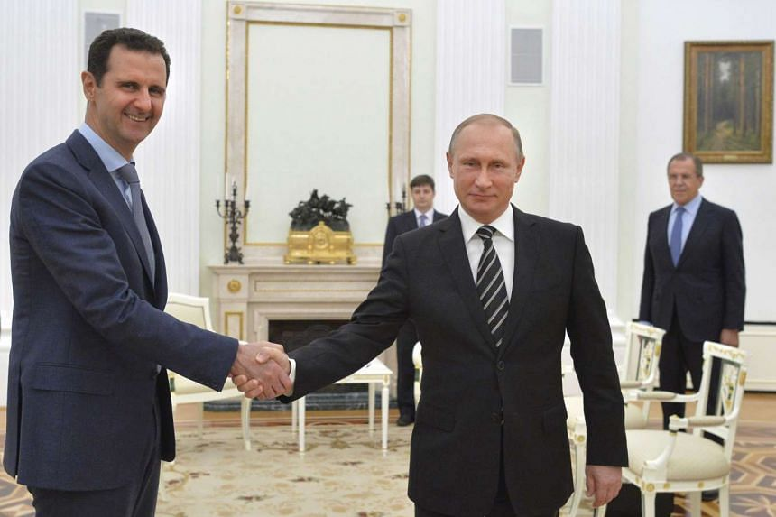 Russian President Vladimir Putin shakes hands with Syrian President Bashar al-Assad during a meeting at the Kremlin in Moscow, Russia, on October 20, 2015.