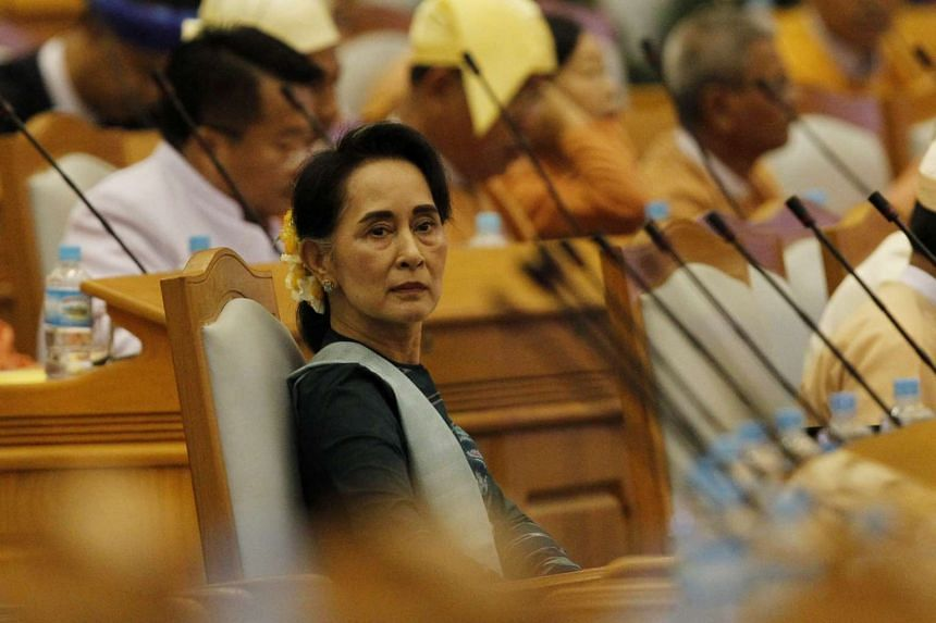 Aung San Suu Kyi (centre) arrives to a union parliament session in Naypyitaw, Myanmar on March 15, 2016.
