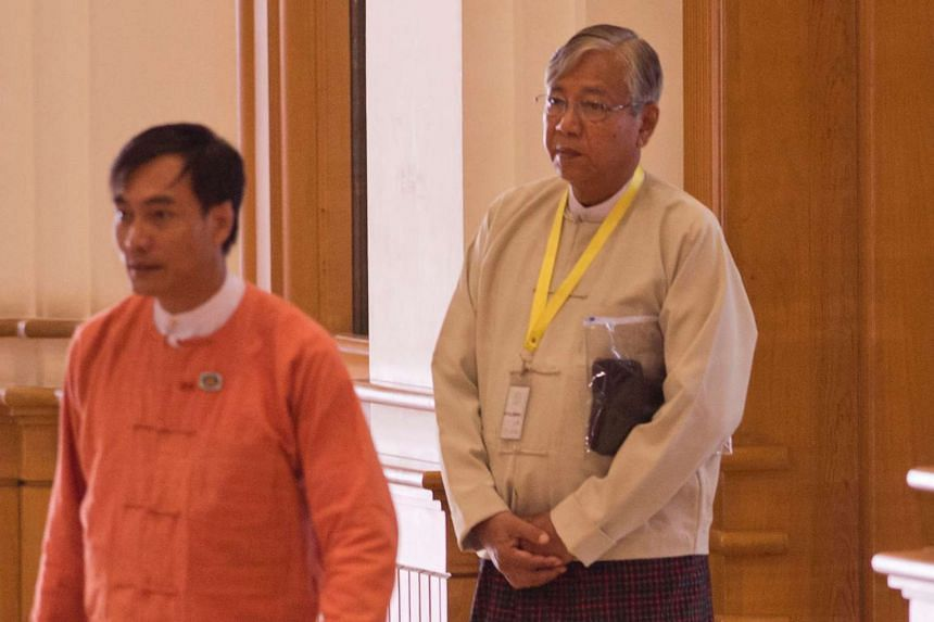 Htin Kyaw (right) a trusted confidante and anointed proxy of Myanmar democracy icon Aung San Suu Kyi arrives at the parliament on March 15, 2016.