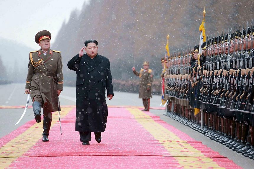 North Korean leader Kim Jong Un salutes during a visit to the Ministry of the People's Armed Forces.