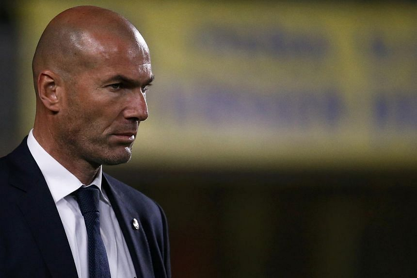 Real Madrid's coach Zinedine Zidane reacts before match, on March 13, 2016.