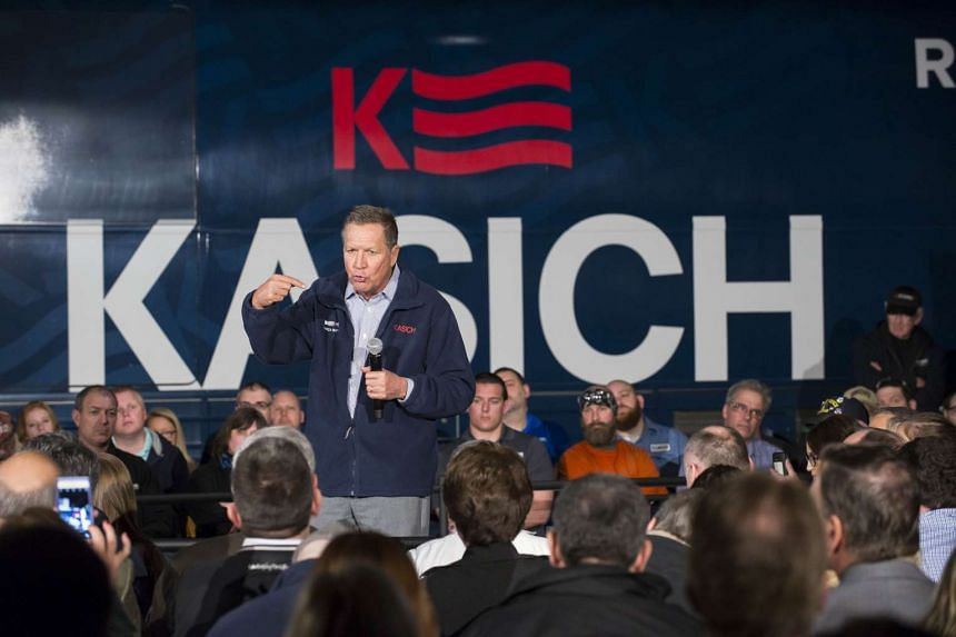 Republican presidential candidate Ohio Gov John Kasich speaks to supporters at a town hall meeting in Youngstown, Ohio on Monday.