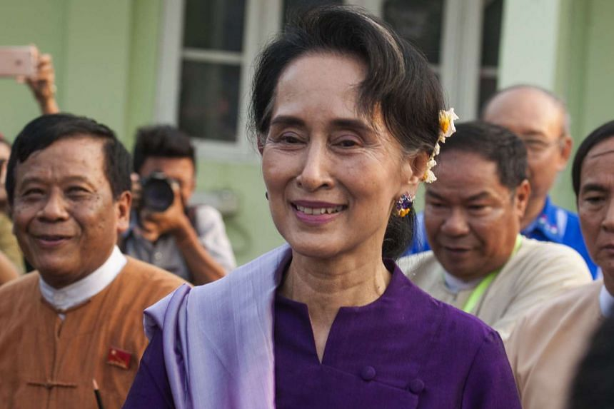 Myanmar democracy icon Aung San Suu Kyi leaves after meeting members of parliament belonging to her political party on Monday.