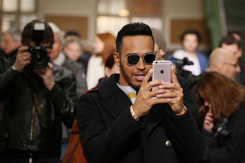In the selfie-style video, Hamilton is riding a Harley-Davidson down the motorway, with the angle panning across his shoulder to show the traffic behind him.