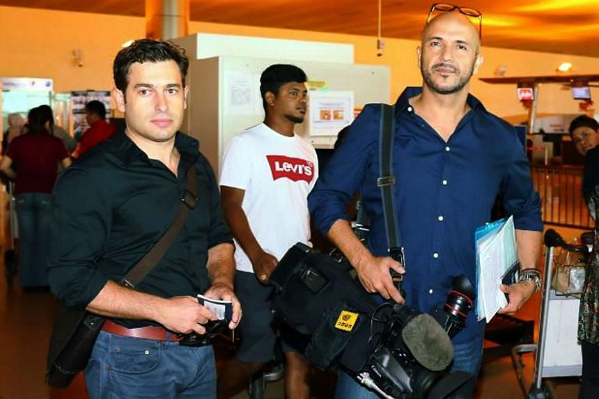 Reporters Linton Besser (left) and Louie Eroglu (right) were detained for attempting to question Prime Minister Najib Razak over corruption allegations.