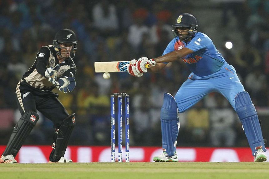 India's Ravichandran Ashwin (right) plays a shot watched by New Zealand's wicketkeeper Luke Ronchi at the World Twenty20 cricket tournament in Nagpur, India, on March 15, 2016.