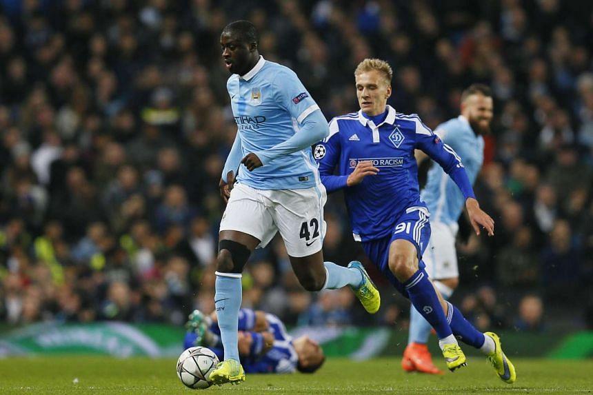 Manchester City's Yaya Toure in action with Dynamo Kiev's Lukasz Teodorczyk.