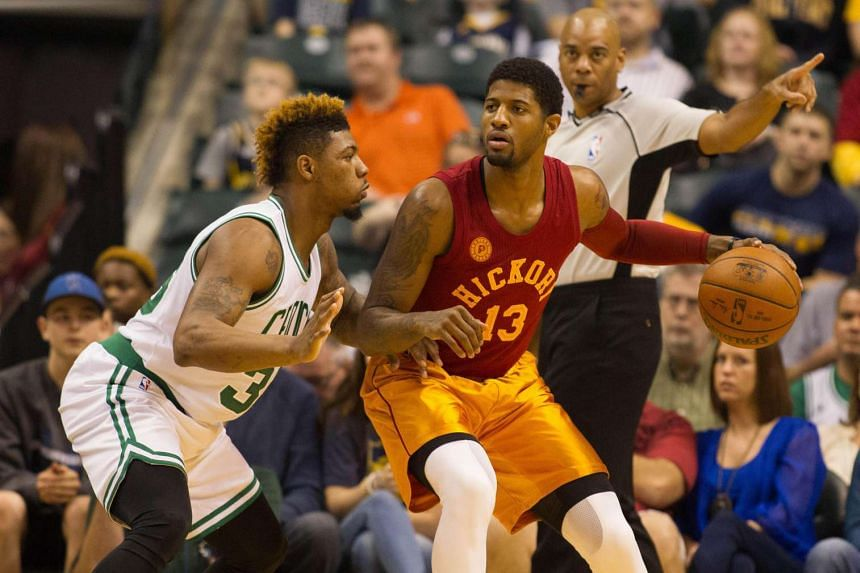 Indiana Pacers forward Paul George (right) backing down against Boston Celtics guard Marcus Smart in Indianapolis on March 15, 2016.