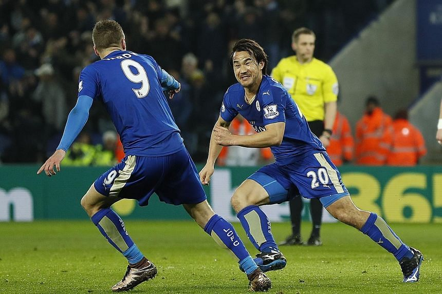 Shinji Okazaki wheels away to celebrate what turned out to be the winner with his strike partner Jamie Vardy, as Leicester City earned a 1-0 win over a Rafa Benitez-led Newcastle side. With eight games to go, Leicester are five points ahead of second
