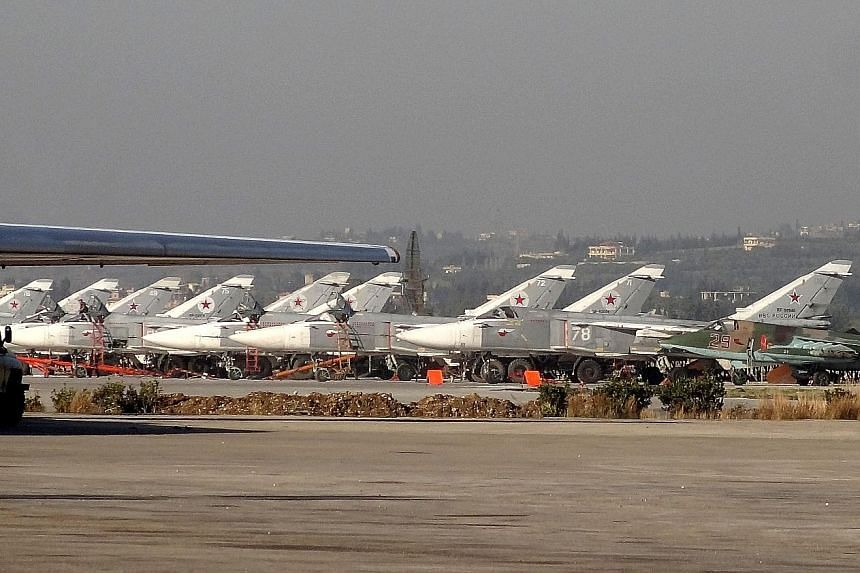 Russian jets at Hmeimim airbase in Syria last month. President Vladimir Putin announced a surprise pullout from Syria on Monday, with the UN's Syria envoy expressing hope it could help peace talks.