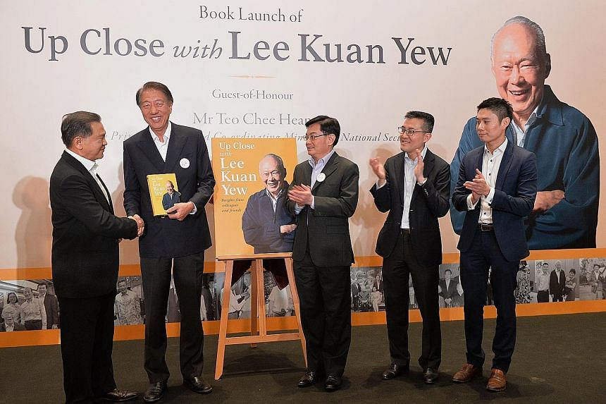 (From far left) Changi Airport Group chairman Liew Mun Leong presenting the book, Up Close With Lee Kuan Yew, to DPM Teo Chee Hean, along with Finance Minister Heng Swee Keat, Maritime and Port Authority chief executive Andrew Tan and Temasek Holding