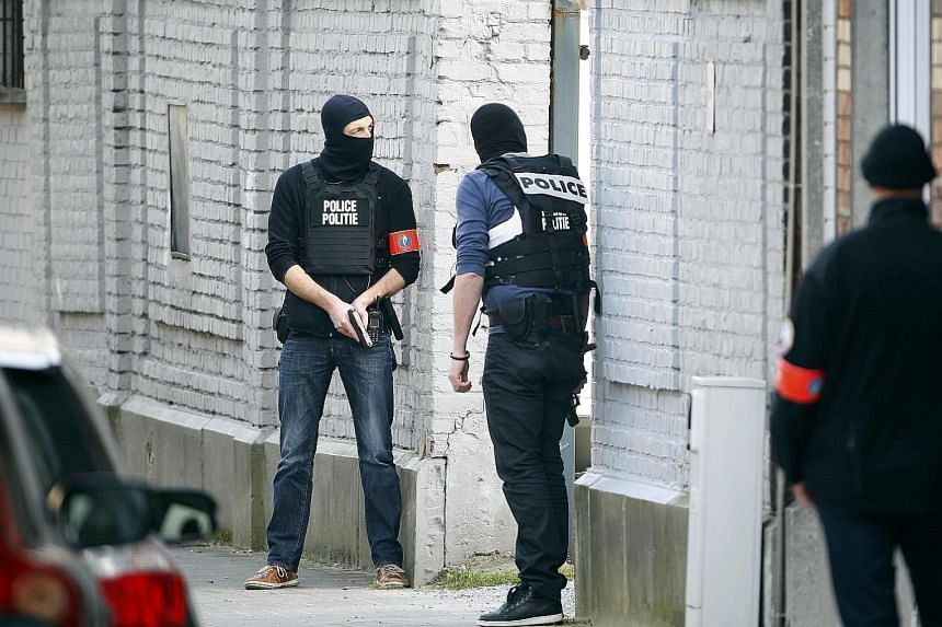 Armed police locked down a section of the Belgian capital yesterday as they hunted for a gunman who is on the run after he shot at the police.