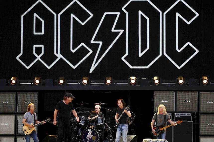 AC/DC members (from left) Stevie Young, Brian Johnson, Chris Slade, Angus Young and Cliff Williams rehearse in a 2015 file photo.