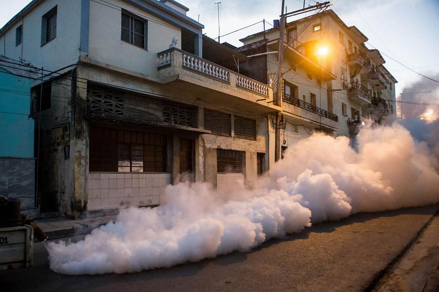 Health authorities with the help of the Cuban army fumigate the streets of Havana.