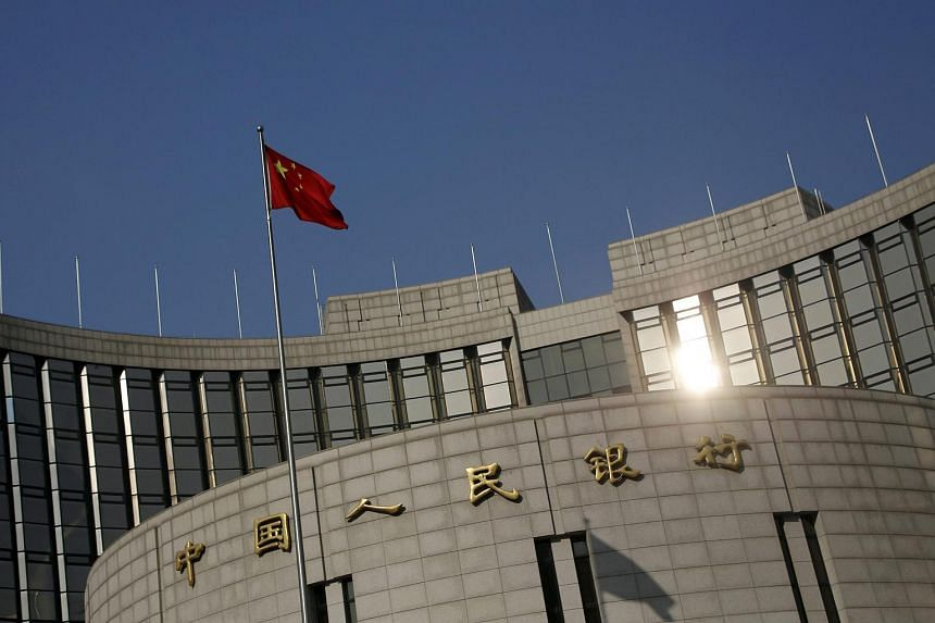 A Chinese flag flying at the headquarters of the People's Bank of China in Beijing, China, on Jan 19, 2016.