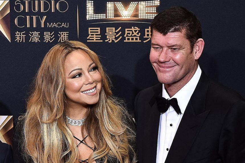 Mariah Carey (left) and James Packer arrive on the red carpet ahead of the opening ceremony of the Studio City casino resort in Macau.